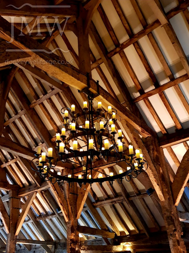 wrought-iron-chandelier-tithe-barn-wedding-venue-donkeywell-forge