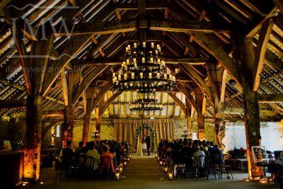 wrought-iron-chandelier-tithe-barn-wedding-venue-donkeywell-forge