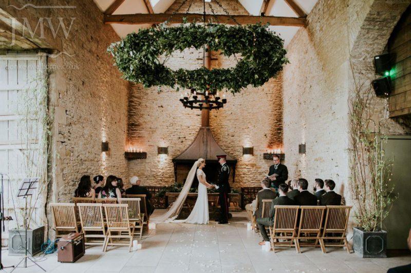stone-barn-wedding-venue-hanging-flower-ring-iron-donkeywell-forge