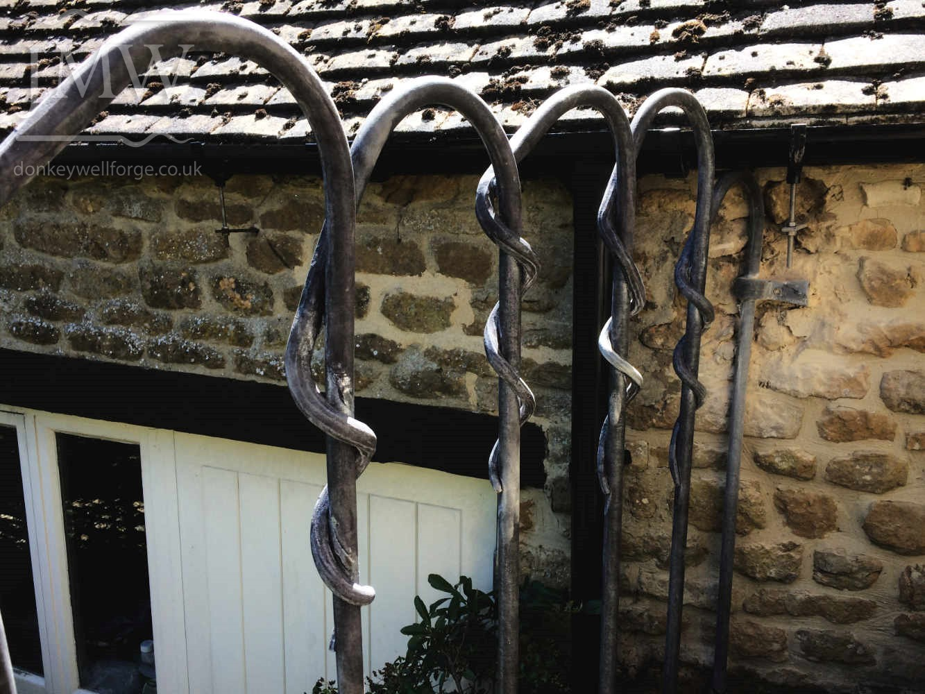 stair-railing-bespoke-zinc-lead-finish-iron-flowers-garden-donkeywell-detail-donkeywell-forge