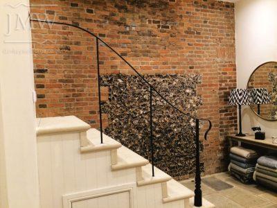 Ornate-stair-handrail-iron-donkeywell