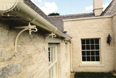 ornate-iron-gutter-bracket-gloucestershire-country-house-bespoke