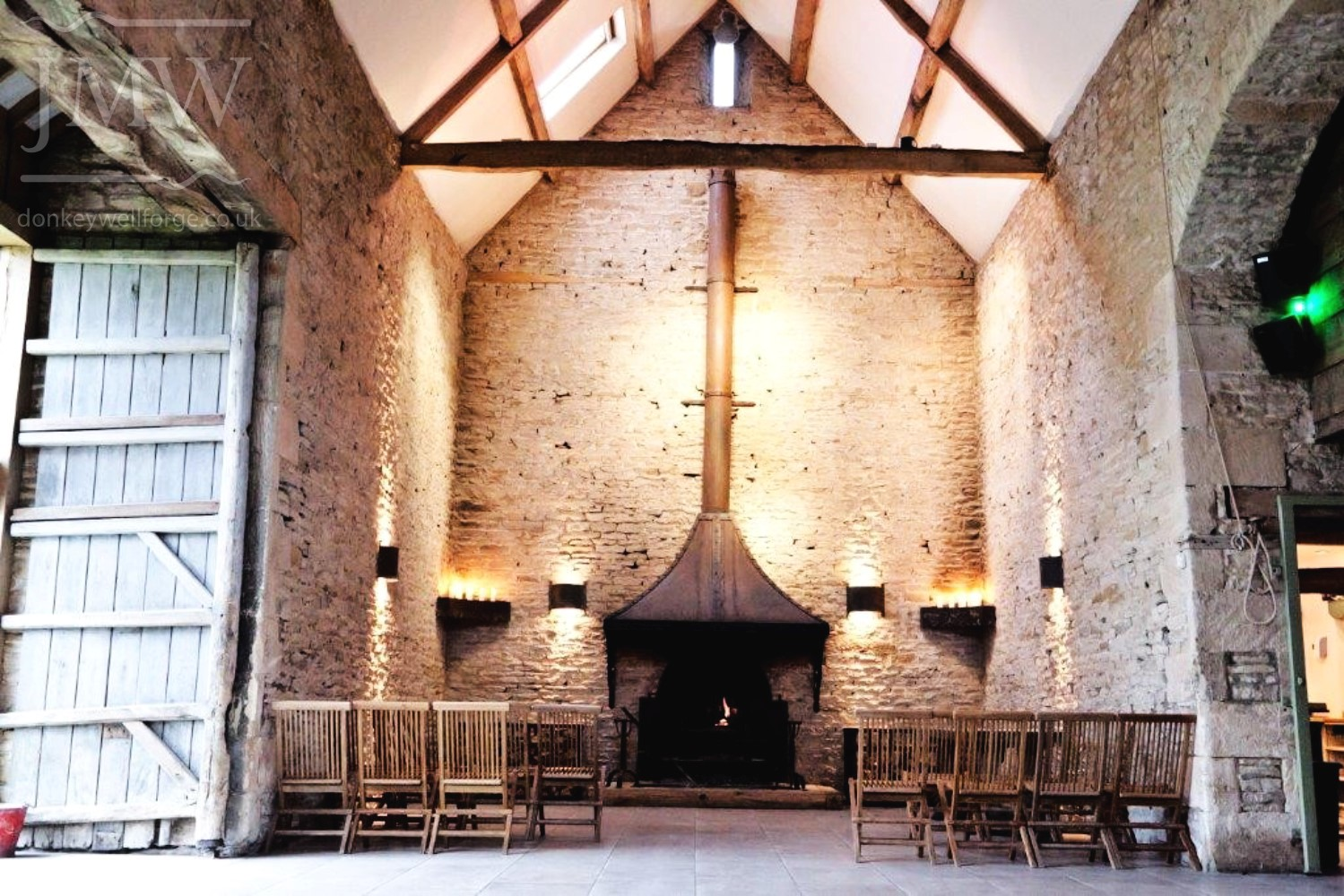 firehood-chimney-iron-wedding-venue-cotswolds-barn-donkeywell-forge-riveted