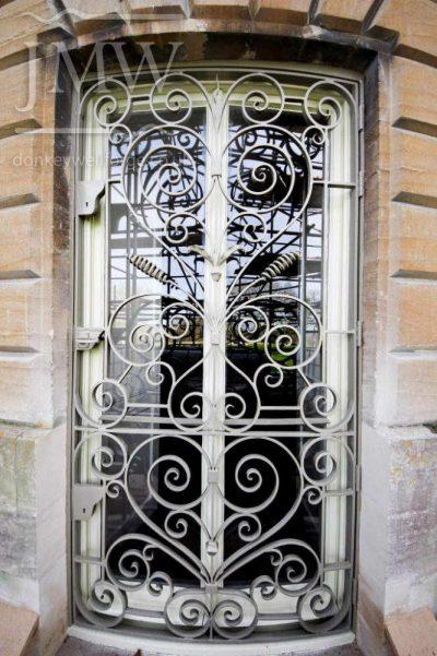 bespoke-window-grilles-iron-ornamental-scrolls-blacksmith-donkeywell-forge