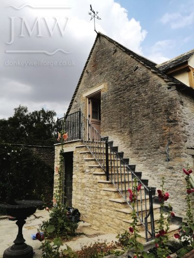 ornate-iron-stair-handrail-iron-cotswolds-donkeywell-forge
