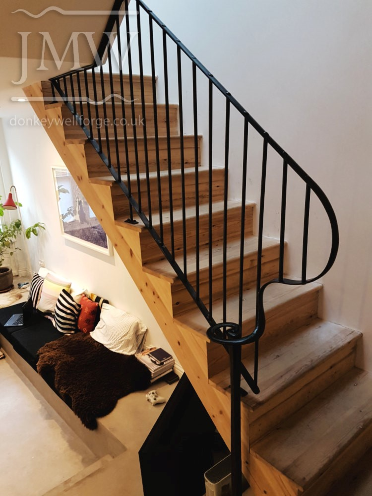 bespoke-ornate-stair-handrail-iron-hand-riveted