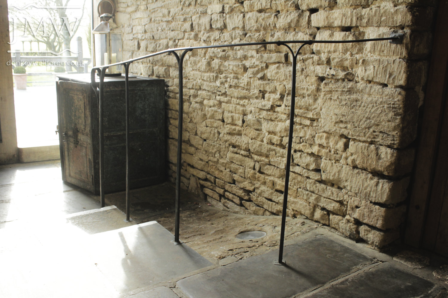 cripps-barn-wedding-venue-handrail-ornate-lead-bases-riveted-forged