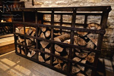 wood-store-chimney-iron-wedding-venue-gloucestershire-stone-barn-riveted