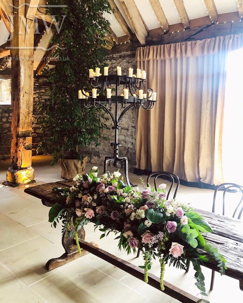 tithe-barn-standing-candelabra-wedding-venue-iron