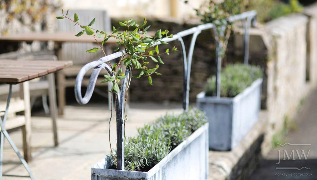 countryside-pub-planter-handrail-riveted-lead-finish-donkeywell-forge