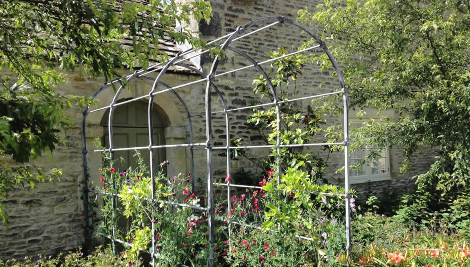 punched-bar-riveted-ironwork-garden-arch-donkeywell-forge