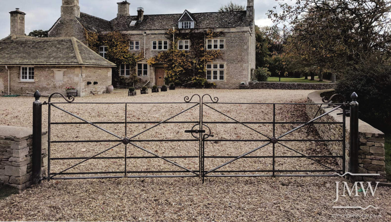 ornate-gates-country-house-hand-forged-ironwork-scrolls-donkeywell-forge