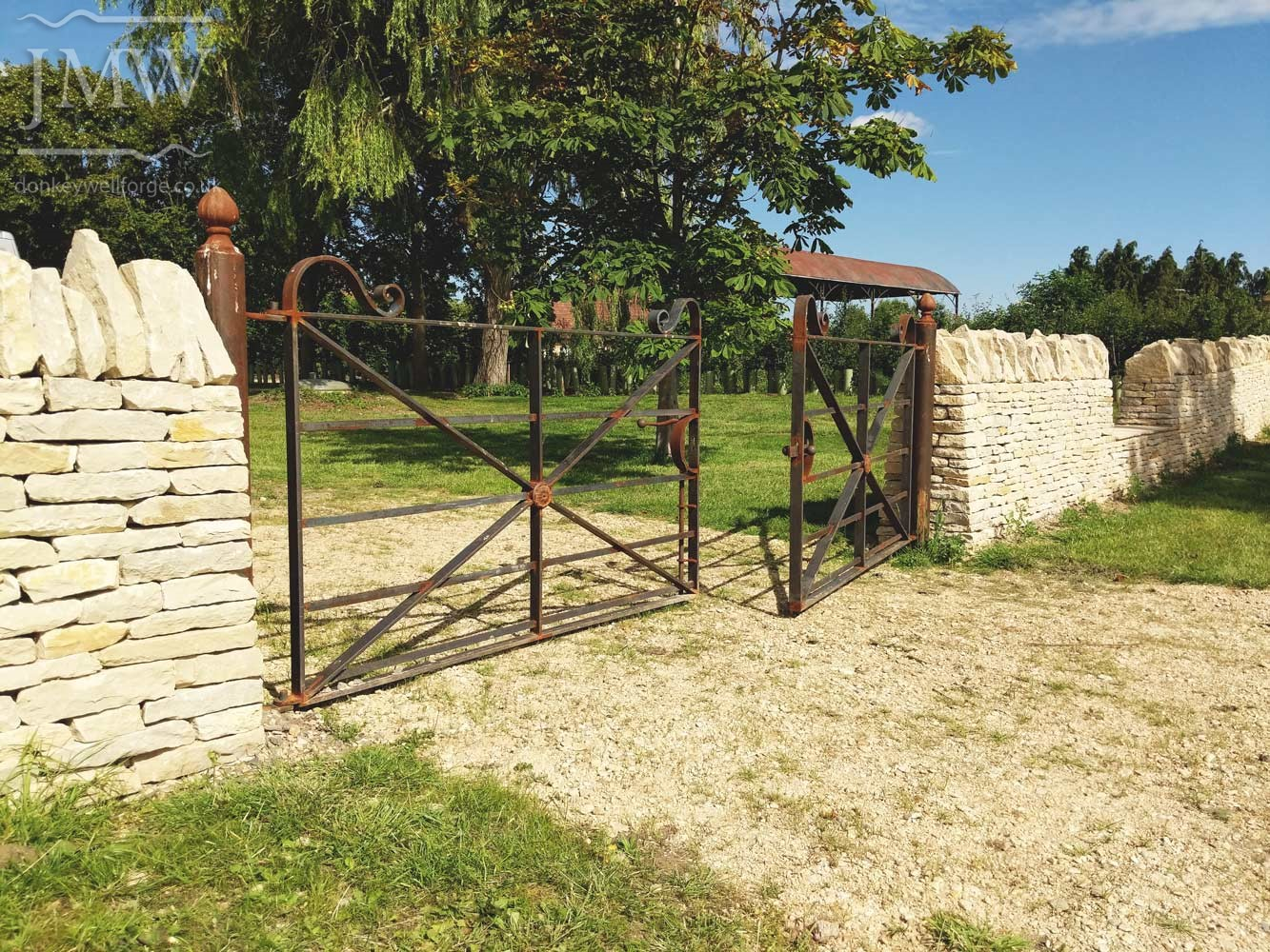 ornate-ironwork-country-house-gates-forged-scrolls