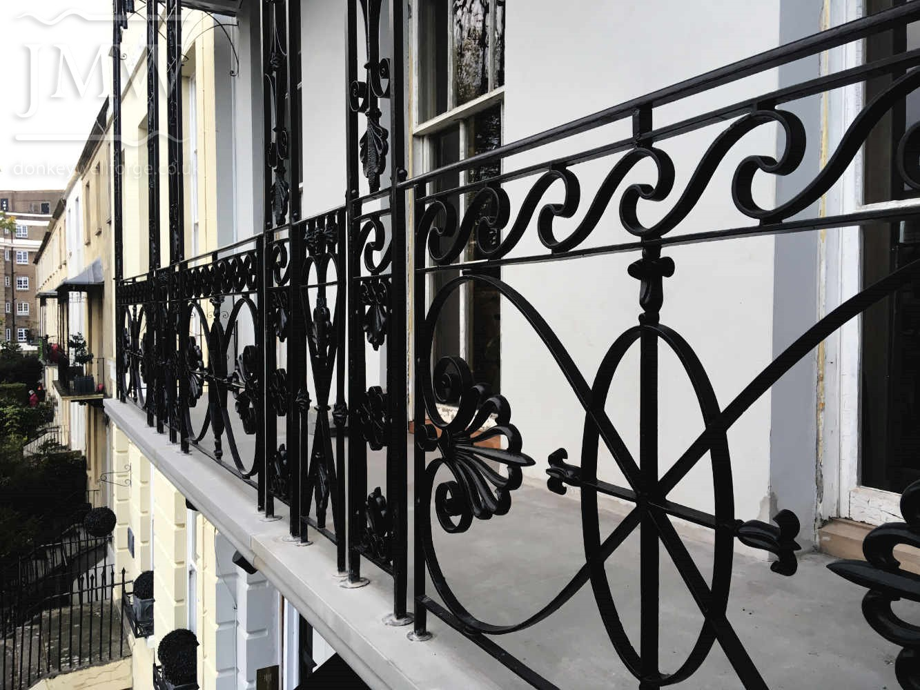balcony-railings-iron-forge-blacksmith-cheltenham-restoration-donkeywell-forge-lead-castings