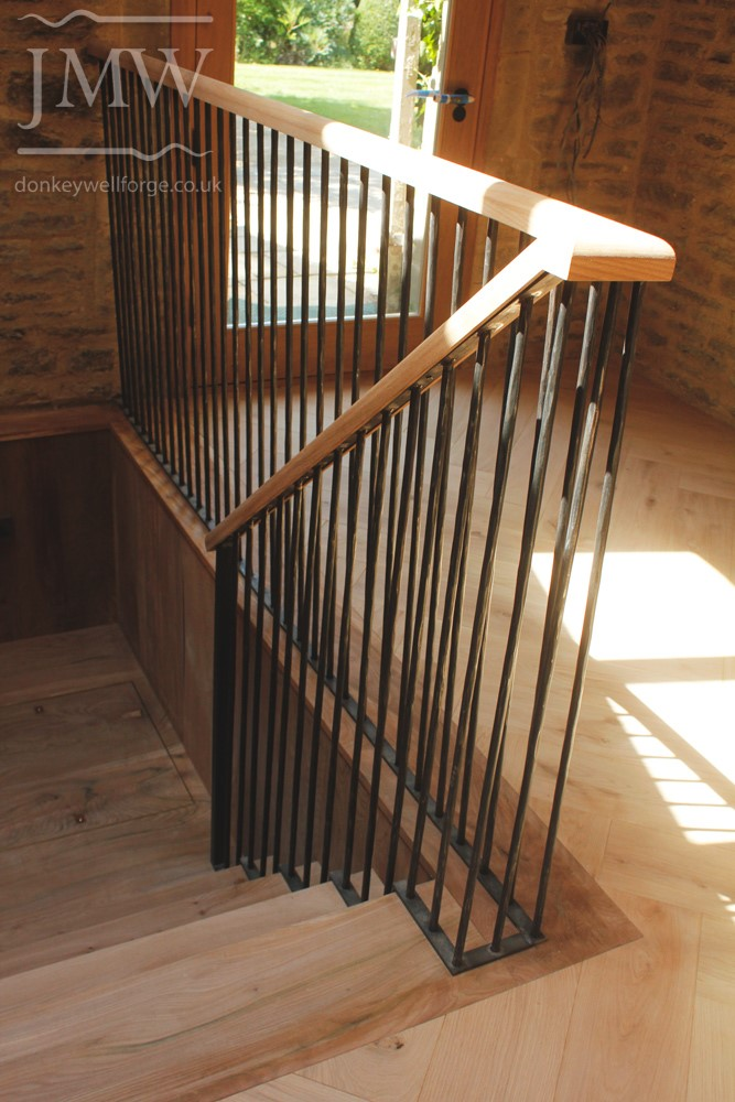 -country-house-forged-stair-balustrades-wooden-handrail