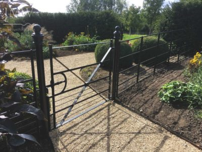 country-house-fencing-gate-ornate-forged-dog-bars