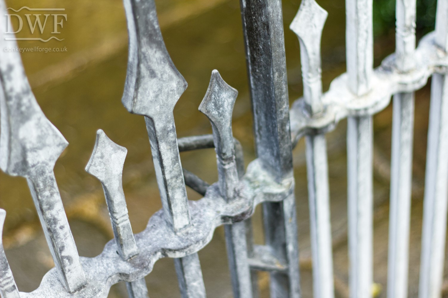 gothic-garden-railings-gates-traditional-ironwork-detail-finials-forged-swellings