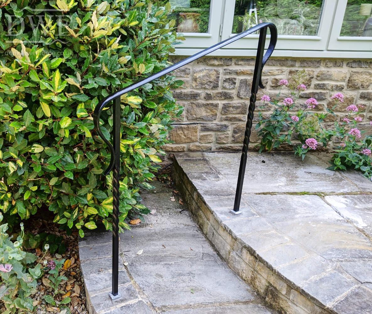 forged-twisted-bars-ornate-scroll-handrails-ironwork