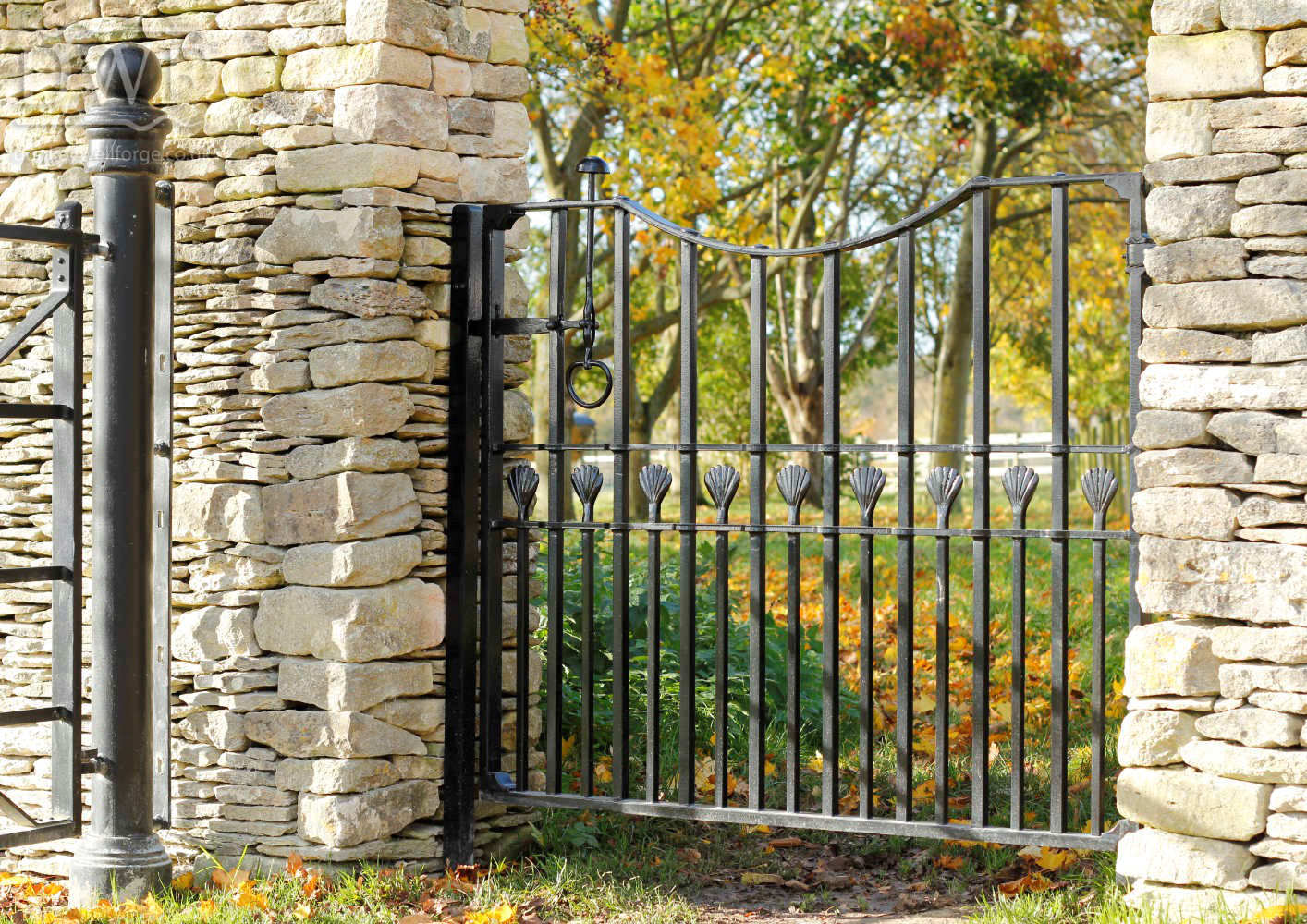 traditional-forged-riveted-ironwork-finials-pedestrian-gate