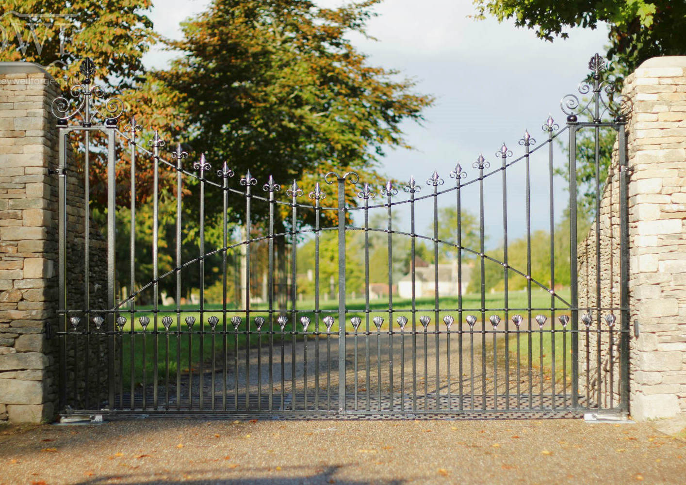 traditonal-forged-riveted-ironwork-finials-entrance-scrollwork-gates