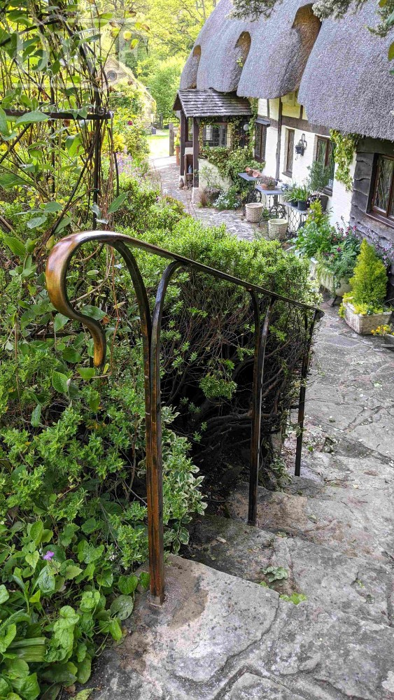 bronze-patina-handrail-forged-worked-iron-riveted